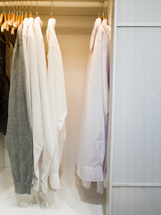 walk -in closet with cloth and shelf at home (lyule4ik) Tags: cabinet clothes clothing design elegance white background clean closet decor inside interior lifestyle luxury modern rack room shelf stylish wardrobe apartment basket beautiful empty floor furniture hanging home house indoor large nobody organized robe shoes storage walk color elegant fashion sale shirt official formal apparel boy button celebration ceremony classic