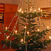 Old-fashioned danish christmas tree with lighted candles