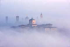 MISTY VISION... (lupus alberto) Tags: bergamo nebbia campanili tramonto armonia bellezza