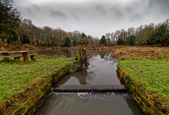 Hardwick hall shooting lake. (S.K.1963) Tags: hardwick hall derbyshire pond water sky trees sculptures bench waterfall grass olympus omd em1 mkii 714mm 28 pro winter snow