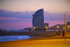 Before the blue hour we get the pink (Fnikos) Tags: sea water waterfront rock seascape beach shore seashore sand playa platja coast seaside walk building tower architecture pink light sky skyline cloud sunset atardecer ship people outdoor