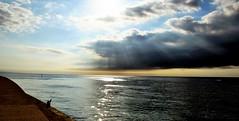 Barcelona and the sea(1):Fishing the first rays of sun (PURIFM) Tags: sea rayofsun sunrise sun morning water brilliant amanecer sol rayodesol outside light barcelona ngc nikon beach playa paisaje landscape soledades mar