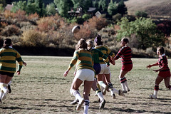 71-889 (ndpa / s. lundeen, archivist) Tags: nick dewolf nickdewolf color photographbynickdewolf 1975 1970s film 35mm 71 reel71 summer fall aspen colorado september ruggerfest aspenruggerfest 8thannual eighthannual rugby tournament women womensrugby woman youngwoman youngwomen player players jersey jerseys uniform uniforms girl girls game playing field rugbyfield valley roaringforkvalley ball