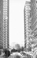 (Vlad Bobe) Tags: monochrome canoneos1v ilfordpanfplus film blackwhite bucharest sky perspective block apartment highrise building 70200mml28isusmii