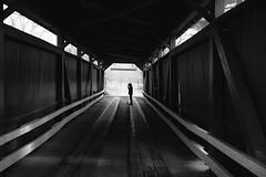 Figure on Bridge (JCTopping) Tags: 6d 40mm street dark people pennsylvania firgure bridge canon blackandwhite boy sad catawissa unitedstates us