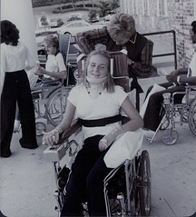 1970s Quad (jackcast2015) Tags: armbraces powerwheelchair handicapped disabledwoman crippledwoman wheelchair quadriplegic quadriplegicwoman teraplegic tetraplegicwoman