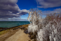 Iced over (Notkalvin) Tags: ice icicles icy cold winter pointbetsie shore lakemichigan michigan beach greatlakes puremichigan lighthouse notkalvin mikekline notkalvinphotography
