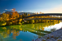 Autumn at the Hammerau-Wals bridge (echumachenco) Tags: river water blue reflection bridge wood construction sky cloud mountain mountainside untersberg tree forest autumn autumncolors fall foliage green wals austria salzburg hammerau bavaria bayern germany deutschland nikond3100 hammerauerbrücke november grass