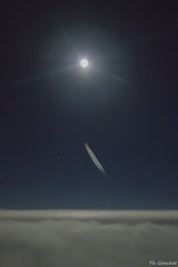 Cruising at full moon night (Philippe Goachet) Tags: airliner aircraft aérien airfrance air avion sky cruise clouds night full moon lune pilotview pilot sony rx100 trainée smoketrail travelling
