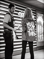 he.got.this (grizzleur) Tags: street streetphotography type typography message girl cop police officer airport candid driveby olylove bw mono monochrome