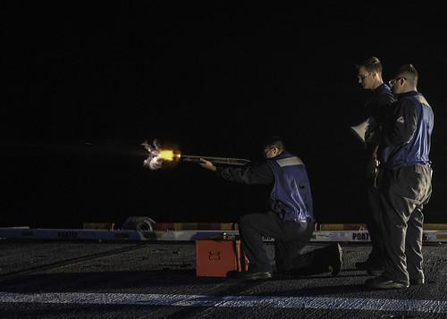Sailors live-fire qualification course aboard USS Essex (LHD 2).