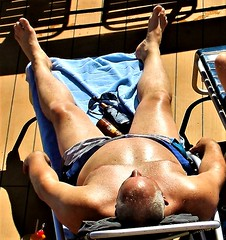 people on cruise pool deck (miosoleegrant2) Tags: tatoo shirtless ship deck cruise vacation sea bare chest sunning male men hunk muscle masculine pecs torso guy chested nipples abs navel outdoor water sport burly strapping backpack belly bald older mature
