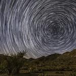 North Star Trails Over Lush Desert Landscape thumbnail