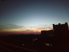 Evening. (Somersaulting Giraffe) Tags: outdoor evening clouds blue black silhouette building architect orange yellow