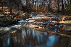Croydon Creek Long Exposure (John Brighenti) Tags: outdoors nature outside natural autumn fall sunny afternoon sky blue trees leaves rocks croydoncreek park rockville maryland md recreation hiking walking photography sony alpha a7rii sel28f20 ilce7rm2 exposure longexposure creek river stream water waterfall flow