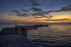 Walkway to sunrise (grantthai) Tags: pier walkway jetty quay sea shore coast wood wooden sun sunrise dawn morning sky clouds island mainland thailand rayong