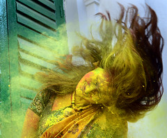 COLOR AND MOTION (Arunabha Kundu) Tags: holi festival culture travel people street face colors portrait nikon india motion ngc lady yellow expression hair
