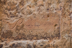 Name Carved into Inscription Rock in El Morro National Monument (Lee Rentz) Tags: antiquitiesact cibolacounty coloradoplateau elmorro elmorronationalmonument inscriptionrock inscriptionrocktrail newmexico theodoreroosevelt trailoftheancientsbyway america americanwest archaeological archaeology carved carving cultural culture desert dry historic history horizontal interpretation interpretive journey landscape name nature northamerica oasis passing path pool promontory record rock route sandstone script source southwest stone trail travel traveler usa water wateringhole west