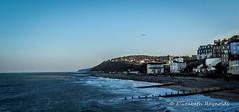 Day 321. (lizzieisdizzy) Tags: cromer pier norfolk seascape cliffs groynes breakwater water waves rollingwaves victorian buildings seaside popularresort
