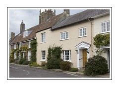 An English Village (Audrey A Jackson) Tags: canon60d dorset cerneabbas village church doors windows street chimneys sky clouds shrubs