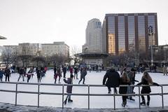 Rosa Parks Circle Ice Skating (DJ Wolfman) Tags: ice iceskating grandrapids grandrapidsmi westmichigan winter christmas white city urban people buildings cityscapes olympus olympusomd em1markii 12mmf14panasonic micro43 sunday