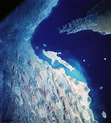 Iran, Trucial Coast, Oman, Zagros Mountains, and Qishm Island (large island at lower left), as seen from the Gemini-12 spacecraft during its 25th revolution of Earth. Original from NASA. Digitally enhanced by rawpixel.