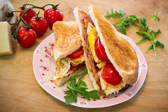 Bacon Egg and Tomato Sandwich (do_japan) Tags: bacon egg cheese parmesan tomato cherry garlic arugula plate food bread toast rocket canadian australian roquette garnish sandwich finger wood board cutting meal dining breakfast lunch