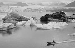 Standing Navigator (peterkelly) Tags: iceland bw bestoficeland digital canon 6d gadventures jökulsárlónglacierlagoon ice berg glacier glacial water zodiac boat wake iceberg