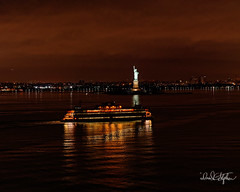 Staten Island Ferry Pass In Front Of Statue of Liberty (dcstep) Tags: dsc0794dxo ferry statenislandferry reflection lights statueofliberty predawnqueen mary 2sony a7riiife 24105mm f4 g ossall rights reservedcopyright 2018 david c stephensdxo photolab 201