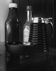 Diner Essentials (arbyreed) Tags: arbyreed monochrome bw blackandwhite diner counter tabasco syrup salsa ketchup restaurant nedras kanab kanecountyutah condimants savetheroadeatmomandpop