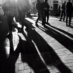 Footfall (Zara.B) Tags: blackandwhite shadows monochrome people street backlit light dark bw footfall
