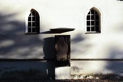 From Shade to Light (czerwiony Smãtk) Tags: genshagen germany windows stone wall shadow light stele symmetry