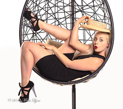 Ooo - Hello, pleased to see you (trethurffe2001) Tags: blackdress blondehair boater eggchair hangingchair lounging portrait strawhat surprise wdcc