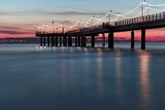 The pier/Il pontile (A_Raven_) Tags: sea mare costa coast seascape panorama pontile italia toscana luci lights sunset tramonto colori colorful sky cielo nuvole clouds paesaggio landscape pink blue longexposure