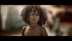 The most powerful weapon on earth is the human soul on fire. ~Ferdinand Foch~ (Lorrainemorris) Tags: child portrait sel70200gm candid cinematography soul light ireland gmaster 70200 sony7rm2 moviestill tones goldenhour sunlight cinematic cinema curlyhair boy