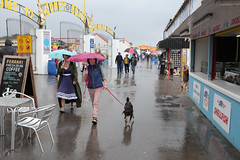 Raining at the Elvis festival (kevin Akerman) Tags: og walking rain umbrella coney beach funfair elvis festival porthcawl