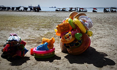 Inflatable Water Toys for Sale (Alexander H.M. Cascone [insta @cascones]) Tags: south america southamerica colombia latinoamerica latin latinamerica hispanic cartagena de los indios beach playa toy infltatable duck donut tube for sale ocean caribbean atlantic sea waves shore sand boats iphone