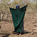 Somali woman drying clothes in an arid area, Afar Region, Gewane, Ethiopia