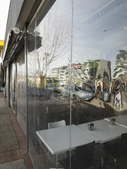 Melting Buildings (oz_lightning) Tags: act australia canberra macquarie people abstract building cars truck reflections australiancapitalterritory aus