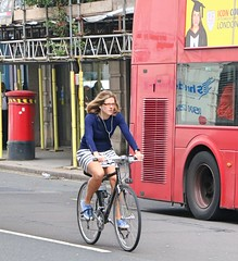 Oxford Street Cyclist (Waterford_Man) Tags: cyclist cycle bike wheels skirt glasses girl london people street candid