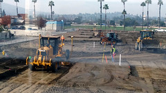 (Rich T. Par) Tags: pomona phillipsranch socal southerncalifornia losangelescounty lacounty constructionsite california palmtrees tree suburb dirt civilengineering sky frontloader tubes pipes heavyequipment grader constructionvehicles tractor road civilengineers parkinglot fence alleyway chainlinkfence