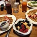 Continental breakfast including waffles, salads, fruit salads, juices