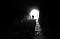 Life is what you make it !! (明遊快) Tags: silhouette monochrome dark tunnel travel outdoor nature love couple sunlight line bw people gr2 トンネル