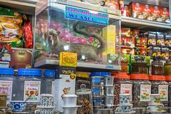 Vendor at Ben Thanh Market in Saigon selling Weasel Coffee and Tea (wuestenigel) Tags: coffeelover lemongrasstea benthanhmarket saigon coffeecup vendor hochiminhcity tea instantcoffee flowertea vietnamesecoffee mostexpensivecoffee weaselcoffee vietnam trungnguyen coffee touristattraction stock shopping einkaufen market markt shelf regal shop geschäft sale verkauf supermarket supermarkt commerce handel bargain schnäppchen booth stand city stadt business option möglichkeit merchandise waren mall einkaufszentrum food lebensmittel displayed angezeigt sell verkaufen noperson keineperson street strase