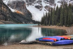 The Canoe Docks of Moraine Lake Lodge on Moraine Lake in Banff National Park (PhotosToArtByMike) Tags: morainelake banff banffnationalpark valleyofthetenpeaks canadianrockies albertacanada mountain mountains emeraldlake bluegreen turquoisecoloredwater canoedocks canoes morainelakelodge