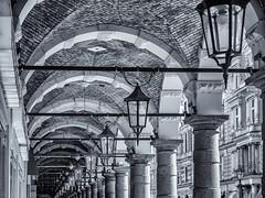 Curves and Lines (katrin glaesmann) Tags: unterwegsmitmichi photowalkwithmichael fotowalkmitmichael fotowalkmitmichio monochrome blackandwhite bw streetlights columns colonnaden arcade