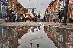 Stony Stratford festivities (jiffyhelper) Tags: apple iphone se stony stratford milton keynes buckinghamshire high street reflection water puddle fair