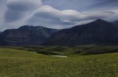 Undulating (charhedman) Tags: flickrcation waterton rollinghills lenticularclouds mountains grassyfields warmerdays june alberta