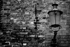The Lamp (Von Noorden) Tags: cultur kultur stadt city town capital streetphotography hamburg noiretblanc einfarbig wand black white blackandwhite bw sw schwarzweiss topv germany schwarz weiss weis schwarzweis shade monochrome street art streetart blackwhite flickrsbest house haus brick entrance building buildings architektur architecture oldtown modern expressionism facade details streets gebäude light lights lampe lamp bricks metal glass gas old kopper church bulb classic historic london blacknwhite