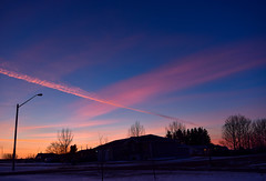 Orange and pink streaks sunset. (darletts56) Tags: sky blue cloud clouds pink orange sunset dusk evening fall silhouette house houses home homes lamp post posts wire wires line lines snow white road village highway prairie saskatchewan canada pole poles light lights black